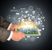 Man hands using tablet pc. Business city on touch. Screen. Business concept Stock Image