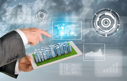Man hands using tablet pc. Business city on touch. Screen. Dramatic sky on background Stock Photo