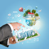 Man hands using tablet pc. Business city on touch. Screen. Earth with buildings near tablet. Element of this image furnished by NASA Stock Photography