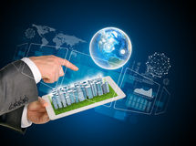 Man hands using tablet pc. Business city on touch. Screen. Earth near tablet. Element of this image furnished by NASA Stock Photography