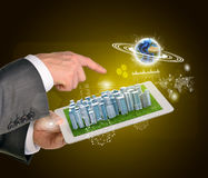 Man hands using tablet pc. Business city on touch. Screen. Earth near tablet. Element of this image furnished by NASA Royalty Free Stock Photography