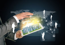 Man hands using tablet pc. Business city on touch. Screen. Network with business silhouettes near computer. Technology concept Royalty Free Stock Images