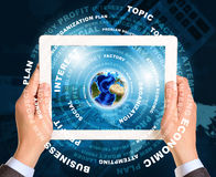 Man hands using tablet pc. Earth and business Royalty Free Stock Photo