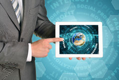 Man hands using tablet pc. Earth and business. Words on touch screen. Element of this image furnished by NASA Stock Photo