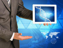 Man hands using tablet pc. Image of DNA helix on Royalty Free Stock Photo