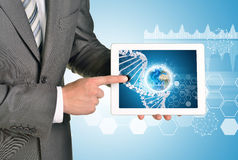 Man hands using tablet pc. Image of Earth and DNA Royalty Free Stock Image