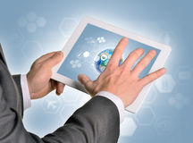 Man hands using tablet pc. Image of Earth on Royalty Free Stock Photography