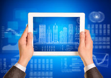 Man hands using tablet pc. Image of wire-frame Stock Images