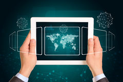 Man hands using tablet pc. Image of world map and Royalty Free Stock Photo