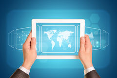 Man hands using tablet pc. Image of world map on Royalty Free Stock Photography