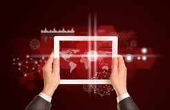 Man hands using tablet pc. Image of world map on Stock Photo