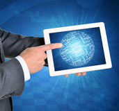Man hands using tablet pc. Sphere of business. Words on touch screen. Graphs as backdrop Royalty Free Stock Images