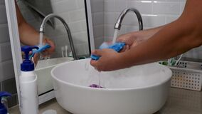 Man hands wash individual blue face masks