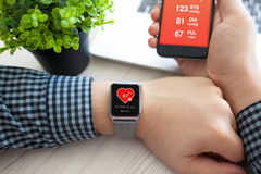 Man hands with watch and phone with app health Royalty Free Stock Photos