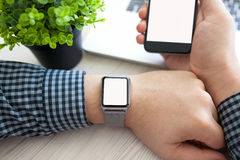 Man hands watch and phone with isolated screen Stock Photos