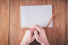Man hands writing notes in notebook Stock Image