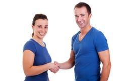 Man handshake a woman. Isolated on white, studio shot Royalty Free Stock Photos