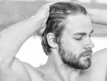 Man handsome bearded just wake up. Macho attractive appearance care about beauty. Essential practices beauty routine stock images