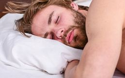 Man handsome guy lay in bed. Get adequate and consistent amount of sleep every night. Expert tips on sleeping better. Bearded man sleeping face relaxing on stock photos