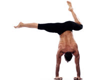 Man handstand full length gymnastic acrobatics. One caucasian man yoga handstand gymnastic acrobatics full length studio isolated on white background Stock Photography