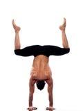 Man handstand full length gymnastic acrobatics. One caucasian man yoga handstand gymnastic acrobatics full length studio isolated on white background Stock Photos