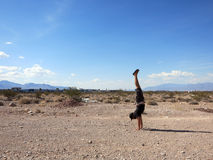 Man Handstanding in the Las Vegas Desert on a clear day Stock Image