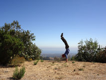 Man Handstands in the high mountains of Santa Barbara Stock Photos