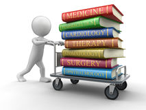 Man and Handtruck Medical textbooks (clipping path included). Man and Handtruck Medical textbooks. Image with clipping path Royalty Free Stock Images