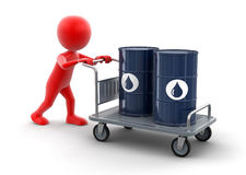 Man and Handtruck with Oil Drums (clipping path included). Man and Handtruck with Oil Drums. Image with clipping path Stock Photo