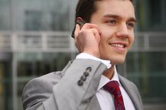 Man with handy. Young man standing and calling up Stock Photo