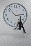 Man hang on clock Stock Images