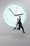 Man hang on clock Royalty Free Stock Photography