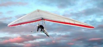 Man hang-gliding at sunset Stock Image