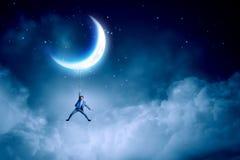 Man hang on moon Stock Image