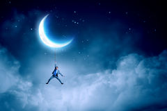Man hang on moon Royalty Free Stock Images