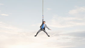 Man hang on rope Stock Image