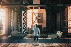 Man in hangar style interior stock photography