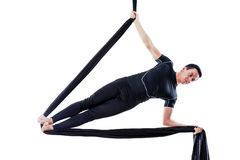 Man hanging in aerial silk, isolated on white. Background Royalty Free Stock Photography