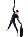 Man hanging in aerial silk, isolated on white. Background Royalty Free Stock Photo