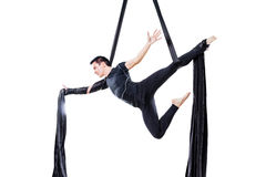 Man hanging in aerial silk, isolated on white. Background Royalty Free Stock Photos
