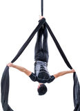 Man hanging in aerial silk, isolated on white. Background Stock Photography