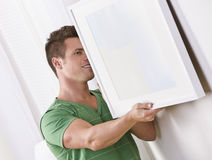 Man Hanging Frame Stock Photos
