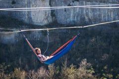 Man in hammock stock image
