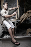 Man hanging from heavy equipment Stock Images