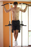 Man hanging on pull up bar Royalty Free Stock Images
