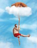 Man hanging on the sausage rope Stock Image