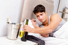 The man with hangover after late partying. Man with hangover after late partying Stock Photo