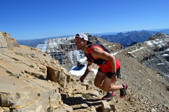 Man Happily Running Up a Mountain Royalty Free Stock Photos