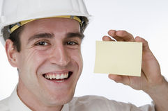 Man happy with card on white Royalty Free Stock Photography