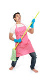 Man happy excited during cleaning Royalty Free Stock Image